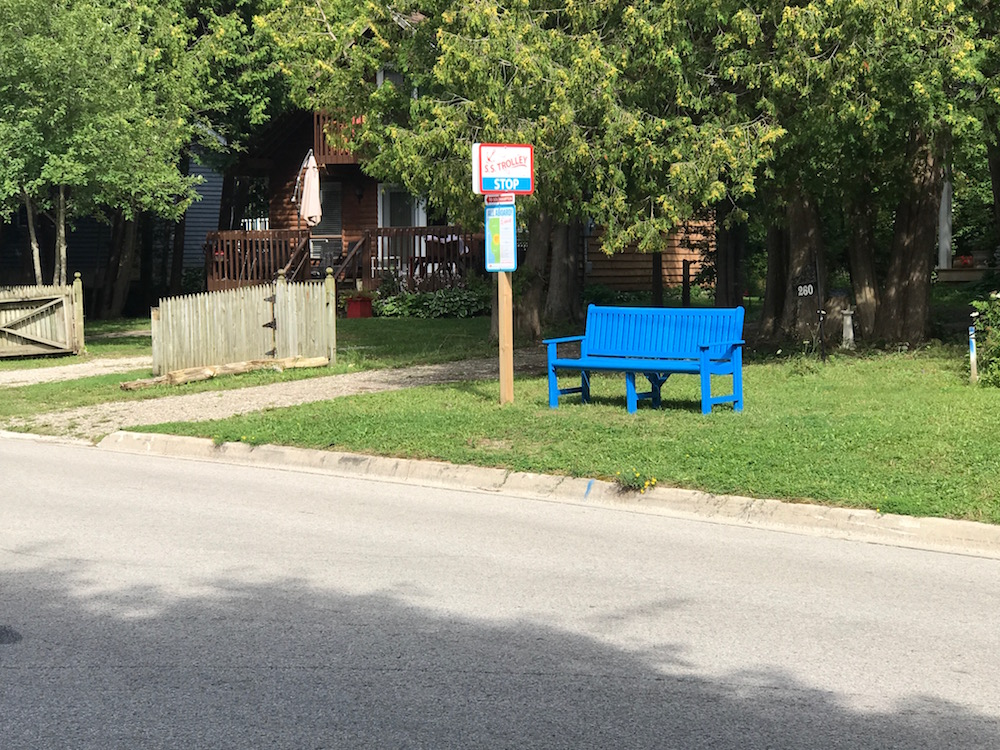 s s trolley stop with blue bench